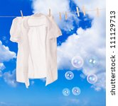 Stock photo white shirt hanging on washing line with soap bubbles against a blue sky 111129713