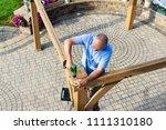 Man Building A Wooden Gazebo O...