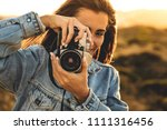 beautiful woman taking picture... | Shutterstock . vector #1111316456