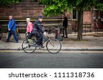 cycling policeman in vintage... | Shutterstock . vector #1111318736