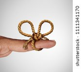 Small photo of Remember knot and reminder symbol as a string tied on a finger to remind and give attention to a future planned event.