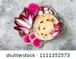 homemade hummus seasoned with... | Shutterstock . vector #1111352573
