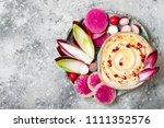 homemade hummus seasoned with... | Shutterstock . vector #1111352576