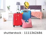 large suitcases and bag packed... | Shutterstock . vector #1111362686