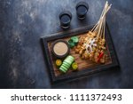 chicken satay or sate ayam  ... | Shutterstock . vector #1111372493