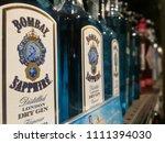 blue gin bottles bombay... | Shutterstock . vector #1111394030
