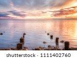 wooden posts lake elton on... | Shutterstock . vector #1111402760