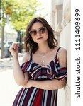 cute brunette with a medium... | Shutterstock . vector #1111409699