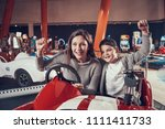 happy smiling mother and son... | Shutterstock . vector #1111411733