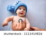 Cute Baby With Blue Cap On...