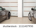 home garage for two vehicles... | Shutterstock . vector #1111437950