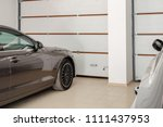 home garage for two vehicles... | Shutterstock . vector #1111437953