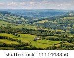 aerial view of green farmland... | Shutterstock . vector #1111443350