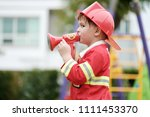 boy playing as fireman police... | Shutterstock . vector #1111453370
