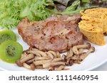 homemade  pork steak  topped... | Shutterstock . vector #1111460954