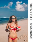 young woman in red bikini with... | Shutterstock . vector #1111478708
