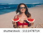 young woman in red bikini with... | Shutterstock . vector #1111478714