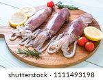 fresh octopus or squids raw on... | Shutterstock . vector #1111493198