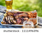 tray of smoked meats texas bbq... | Shutterstock . vector #1111496396