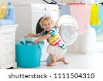 child in laundry room with... | Shutterstock . vector #1111504310