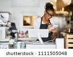 shop assistant taking order on... | Shutterstock . vector #1111505048