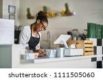 shop assistant taking order on... | Shutterstock . vector #1111505060
