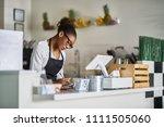 shop assistant taking order on... | Shutterstock . vector #1111505060