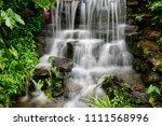 small waterfall in the garden | Shutterstock . vector #1111568996