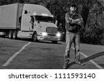 truck driver traveling in the... | Shutterstock . vector #1111593140