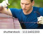 repairman in blue suit cleans... | Shutterstock . vector #1111602203
