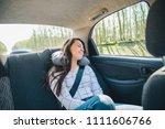 woman at car backseats fasten... | Shutterstock . vector #1111606766