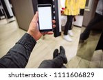 man looking into phone while... | Shutterstock . vector #1111606829