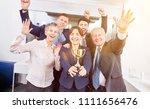 start up team with winner... | Shutterstock . vector #1111656476