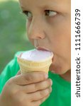 the face of the boy eats ice... | Shutterstock . vector #1111666739