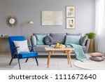blue armchair with pillows... | Shutterstock . vector #1111672640