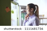 young woman in the kitchen  she ... | Shutterstock . vector #1111681736