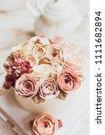buttercream flower cake on... | Shutterstock . vector #1111682894