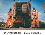 two refuse collection workers... | Shutterstock . vector #1111685363