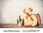 retro teddy bear toy with... | Shutterstock . vector #1111690079