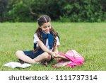 beautiful schoolgirl taking... | Shutterstock . vector #1111737314