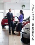 salesman and a woman talking... | Shutterstock . vector #111177410