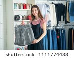 choose new clothes. a young... | Shutterstock . vector #1111774433