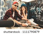 young teen couple sitting by... | Shutterstock . vector #1111790879