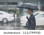 rain in city. young man holding ... | Shutterstock . vector #1111799930
