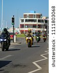 Small photo of Hastings,East Sussex/UK 07/05/18 Bike 1066 the annual May Day bike run to Hastings. A Kawasaki Ninja motorbike and others arrive on the seafront to join thousands of other motorcycles
