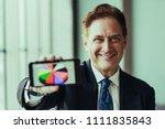 successful mature financier... | Shutterstock . vector #1111835843