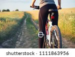girl ride on a bike ion the... | Shutterstock . vector #1111863956