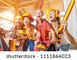 whole family cheering for the... | Shutterstock . vector #1111866023