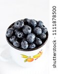 fresh blueberries in a white... | Shutterstock . vector #1111878500