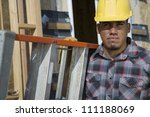 Foreman with ladder at construction site - stock photo